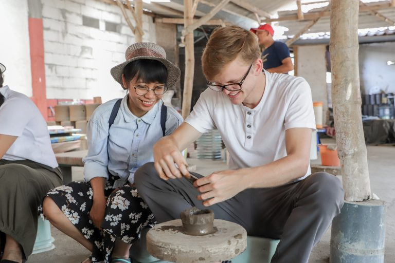 IFLI student learns process of pottery