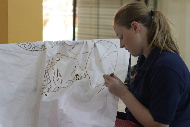 IFLI Students uses wax to make designs on fabric. Traditional Indonesian art of Batik