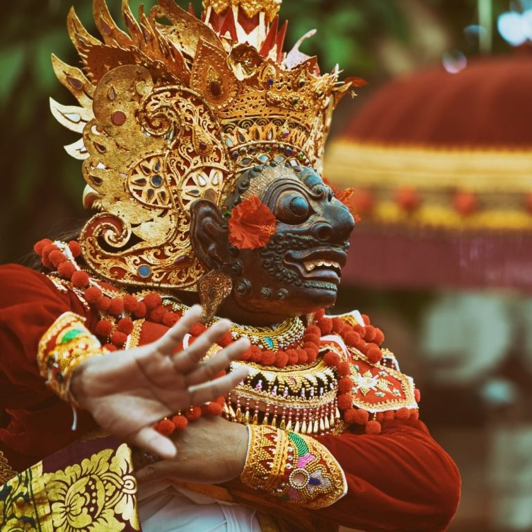 Performer of Indonesian traditionakl dance wearing an ornate mask